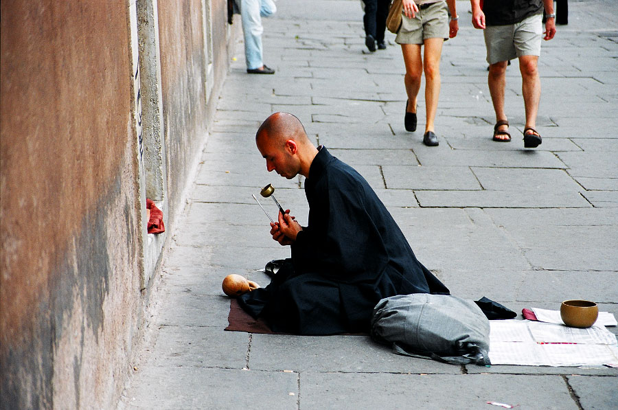 A local monk offers prayers in the city centre.