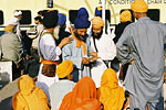 A group of Indian Sikhs congregate at the town's main train station.