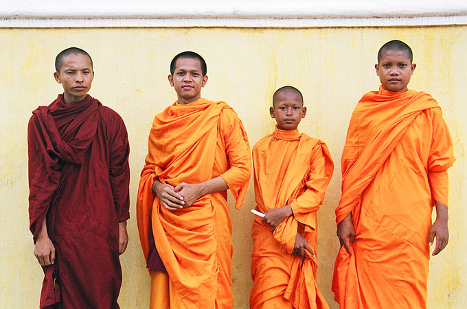 Four novice monks pose for a foreign tourist in the capital.