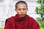 A monk deep in prayer near the Royal Palace.