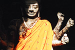 A giant statue of the Hindu god Vishnu inside one of the entrances to Angkor Wat.