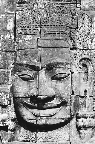 One of the 200 smiling faces adorning the Bayon Temple at Angkor Thom.