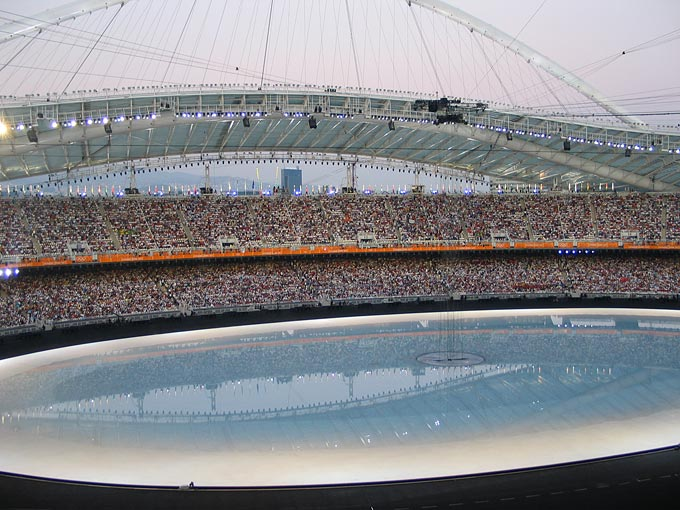 For the opening ceremony, the infield was flooded with millions of gallons of water to symbolize Greece's connection to the sea.