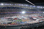 More than 10,000 of the world's best athletes poured into the Olympic stadium for the opening ceremony to the sounds of techno music.