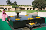 A black marble slab marks the cremation site of India's most cherished leader, Mohandas Gandhi, assassinated in 1948.