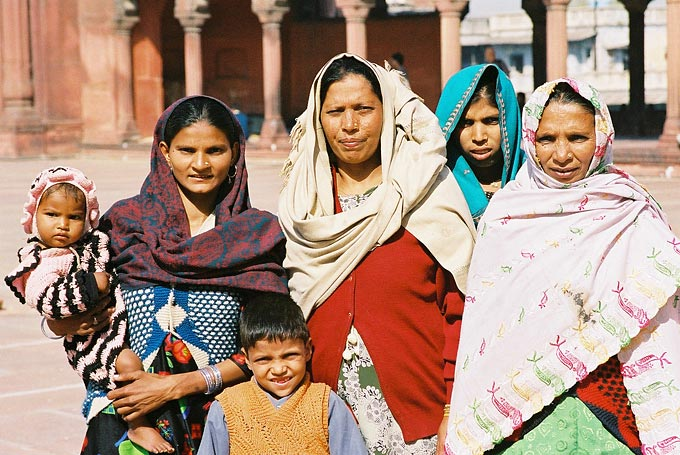 A family poses for a foreign tourist in the grounds of the 17th-century Jama Masjid, one of India's largest mosques.