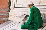 A Muslim man reads the Koran at the 17th-century Jama Masjid, one of India's largest mosques.