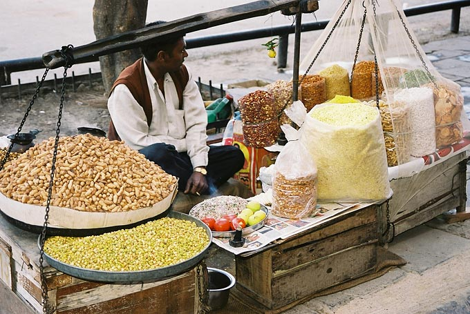 A vendor selling peanuts on the streets of the capital.