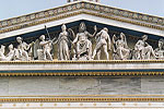 The elegant neoclassical facade of the University of Athens features a frieze depicting the resurgence of arts and sciences under the reign of King Otto.