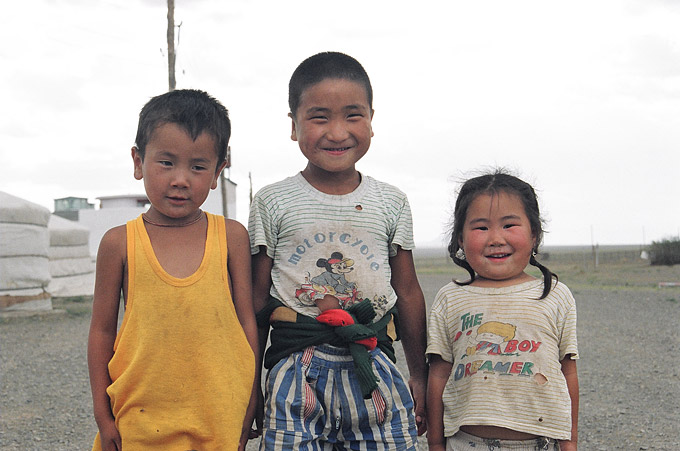 Three siblings sheepishly pose for a foreign tourist at a ger camp in Omnogov, South Gobi.