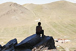 A young boy takes in the view from atop one of the picturesque mountains surrounding the capital.