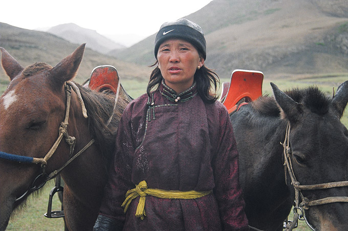 This horsewoman supplements her meagre income by offering hour-long rides to foreign tourists.