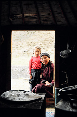A mother and daughter outside their traditional ger. Life in Mongolia, the mother said, was a tough existence.