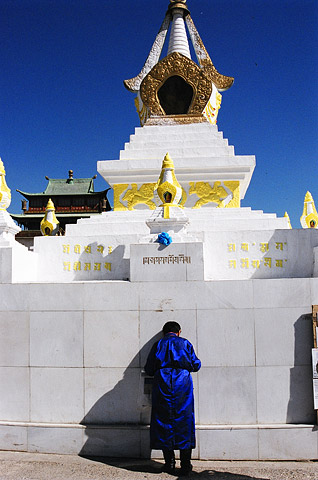 A Mongoliian worshipping at a temple complex in the capital.