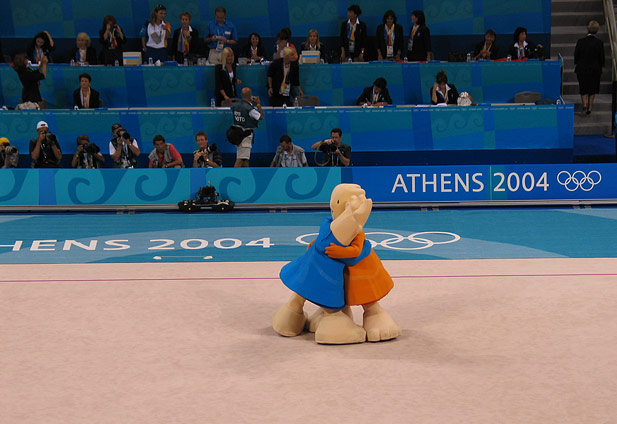 The Olympic Mascots, Phevos and Athena, play up for the foreign media.