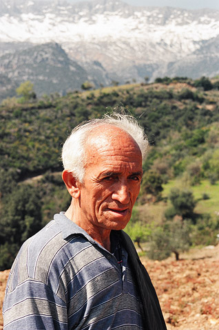 The photographer's uncle during a respite from picking chestnuts in his tiny Greek village of Merkouri, population 65, in the southern Peloponnese.