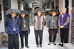 The Hakka women of Kat Hing Wai, a walled village in the New Territories, continue to wear their traditional broad brimmed hats, especially for snap-happy tourists.