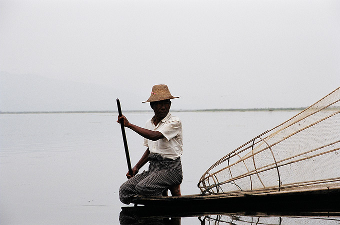 A Burmese fisherman at work on the calm waters of Inle lake, in the country's north-east. The lake features about 17 villages on stilts, inhabited mainly by the Intha people.