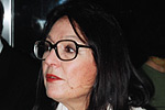The internationally acclaimed Greek-born singer Nana Mouskouri signs autographs after performing for Chinese and foreign concert-goers.