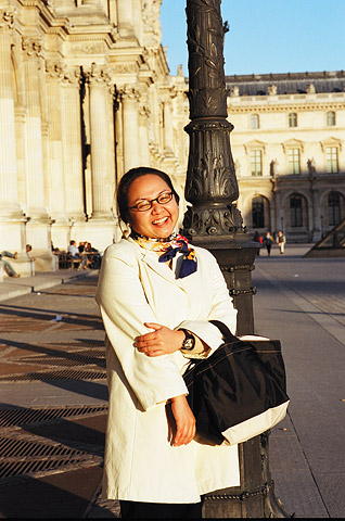 Alexandra A. Seno poses in front of the Louvre Museum.
