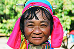 This woman, a Karen refugee from Burma, sports a long, brass coil around her neck common among many of the hill-tribe villages in northern Thailand.