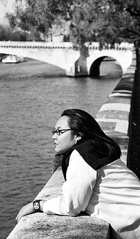 Alexandra A. Seno looks across the Seine.