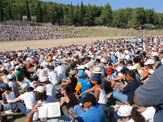 An estimated 40,000 people travelled to the birthplace of the ancient Olympics - more than 1,600 years before - to watch the historic shot put events. Women were allowed to compete for the first time.