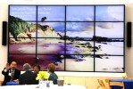 17-ft digital Welcome Artwall showing the image the Community Photomosaic Mural is based on, click to view video content.