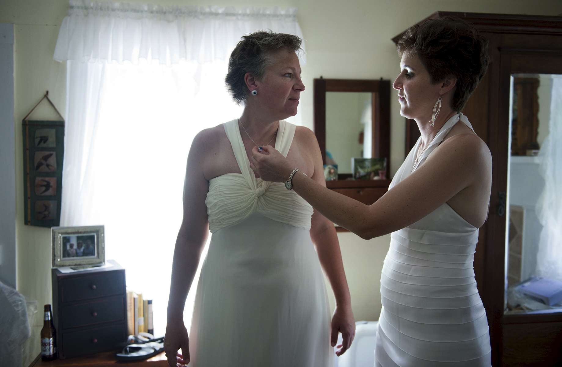 August Burns adjusts the necklace of her fiancé, Denise Ingram, before their wedding ceremony begins. The marriage was an important milestone for the women, who had faced struggles gaining acceptance of their long-term relationship.
