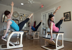 Bull City Pilates and Massage co-owner and instructor Stacy Wolfson, left, and instructors Jessie Parmelee and Anna  Barker practice Pilates in the Durham studio.