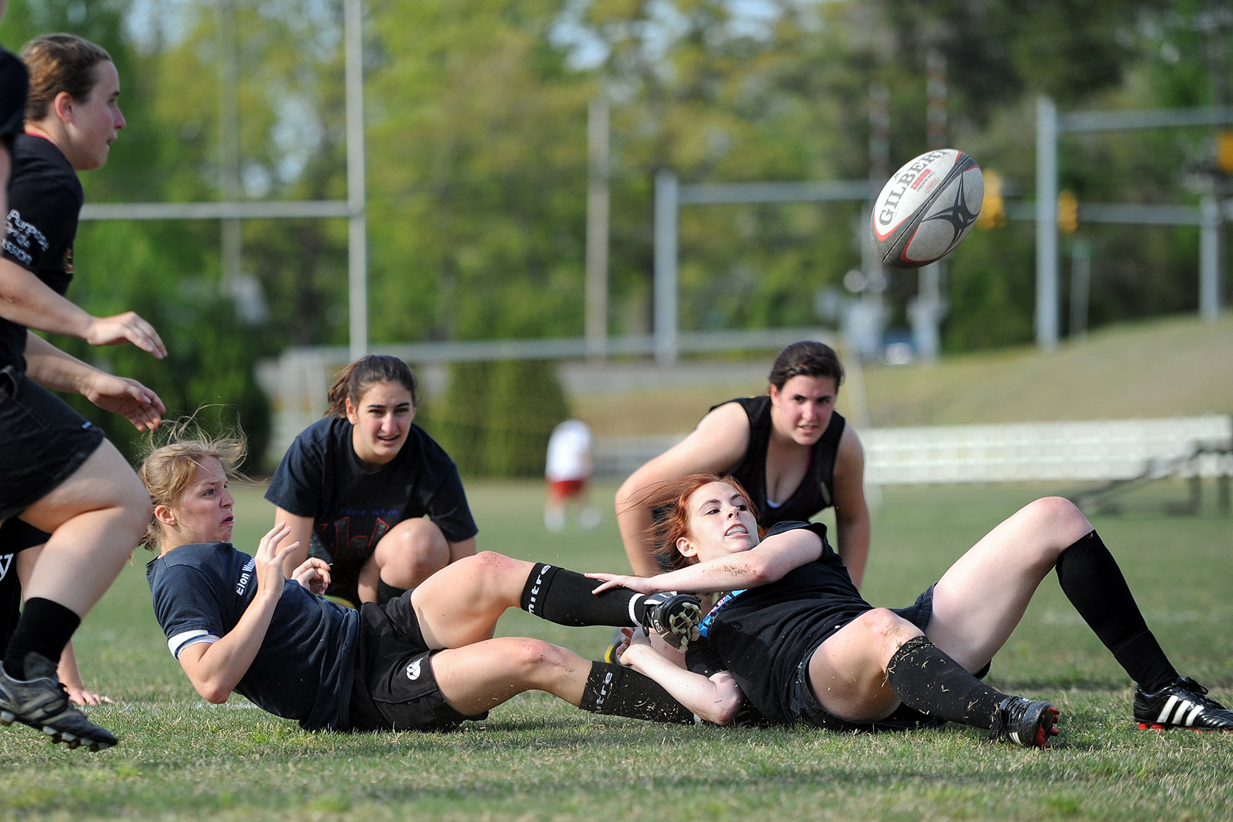 The Elon Women's Club Rugby team practices on south campus.