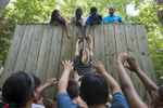 Participants in Elon Academy, a college preparatory program for local high school students, work through group exercises at Elon's Challenge Course.