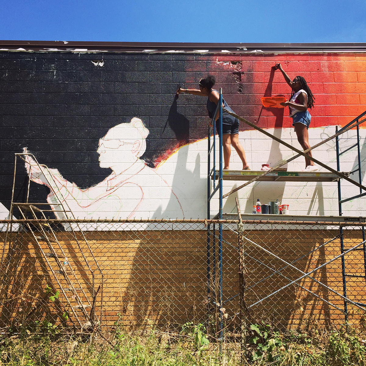 High school students participate in a mural project in the Brightmoor neighborhood of Detroit as part of the College for Creative Studies summer arts programming.