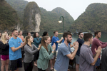 Elon students practice Tai Chi on the deck of a cruise boat on Halong Bay in central Vietnam while studying abroad.