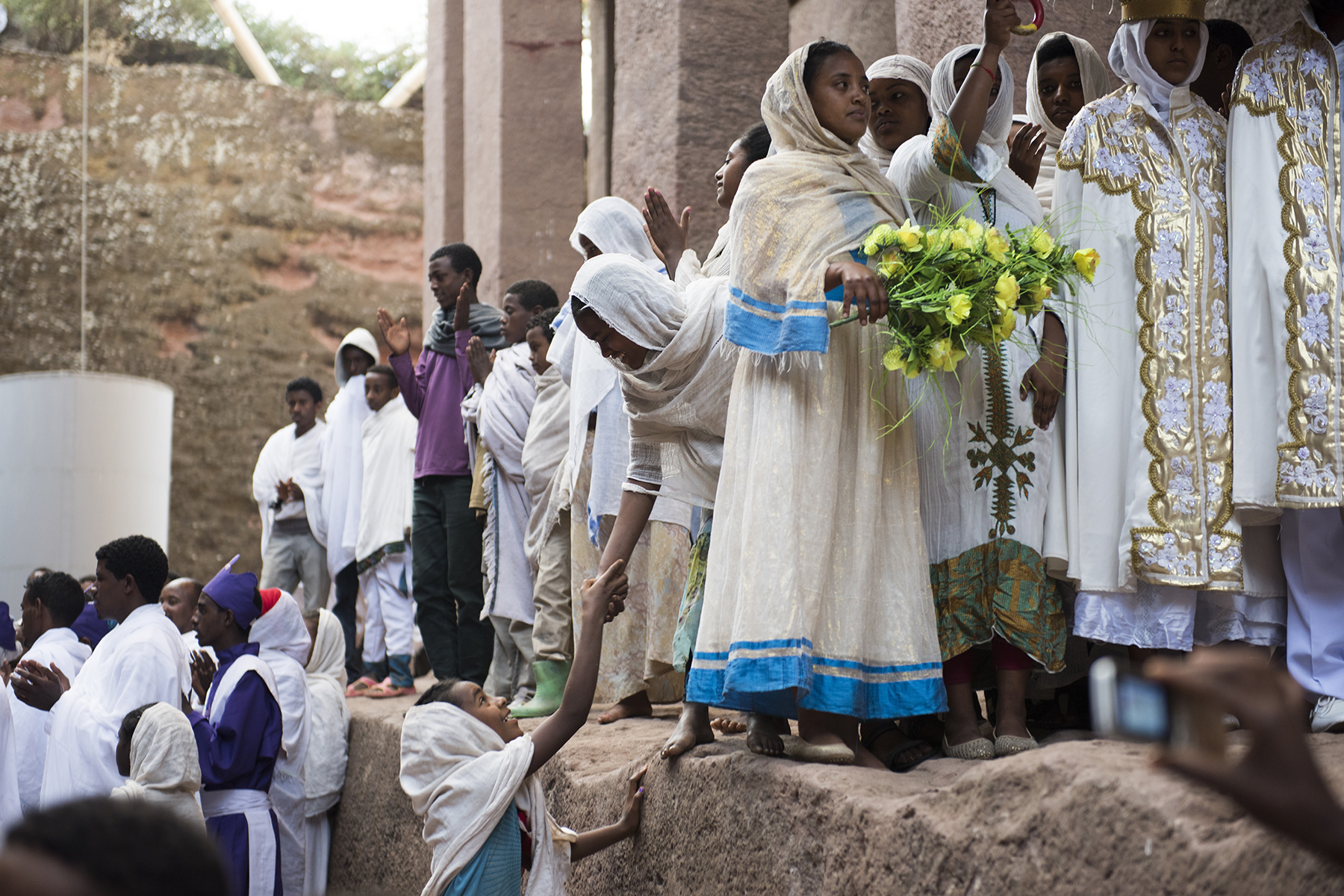 A wedding party winds its way through the rock-hewn Churches of Lalibela in Lalibela, Ethiopia. There are 11 churches, each carved from solid rock in the 12th and 13th centuries as an Ethiopian version of Jerusalem.
