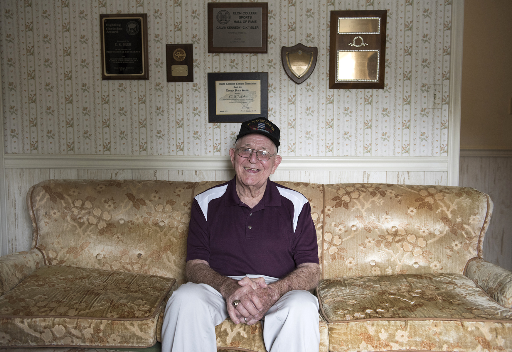 C.K. Siler is an Elon alum who served in the Korean War. He had a contract to play for the Red Sox but was drafted and never got to play professionally. After returning from war and finishing his degree, Siler coached for 36 years.
