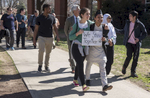 More than 100 students, faculty and staff gathered at Elon's Speakers' Corner on Young Commons to share their concerns and hold a march addressing the president's recent Executive Order regarding immigration.