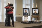 Glenda Phillips Hightower and Eugene Perry '69 are honored with formal portraits during a ceremony to commemorate their roles in Elon's history as the first black student and the first black graduate, respectively.