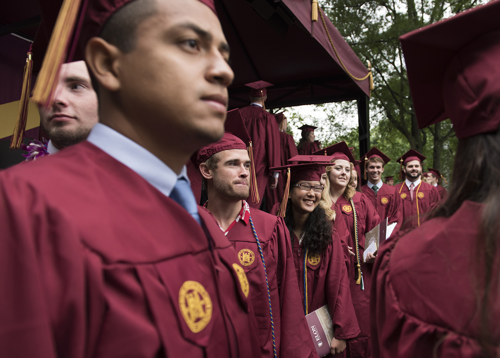 Elon University graduates file around the stage and into their seats as their commencement exercises begin.