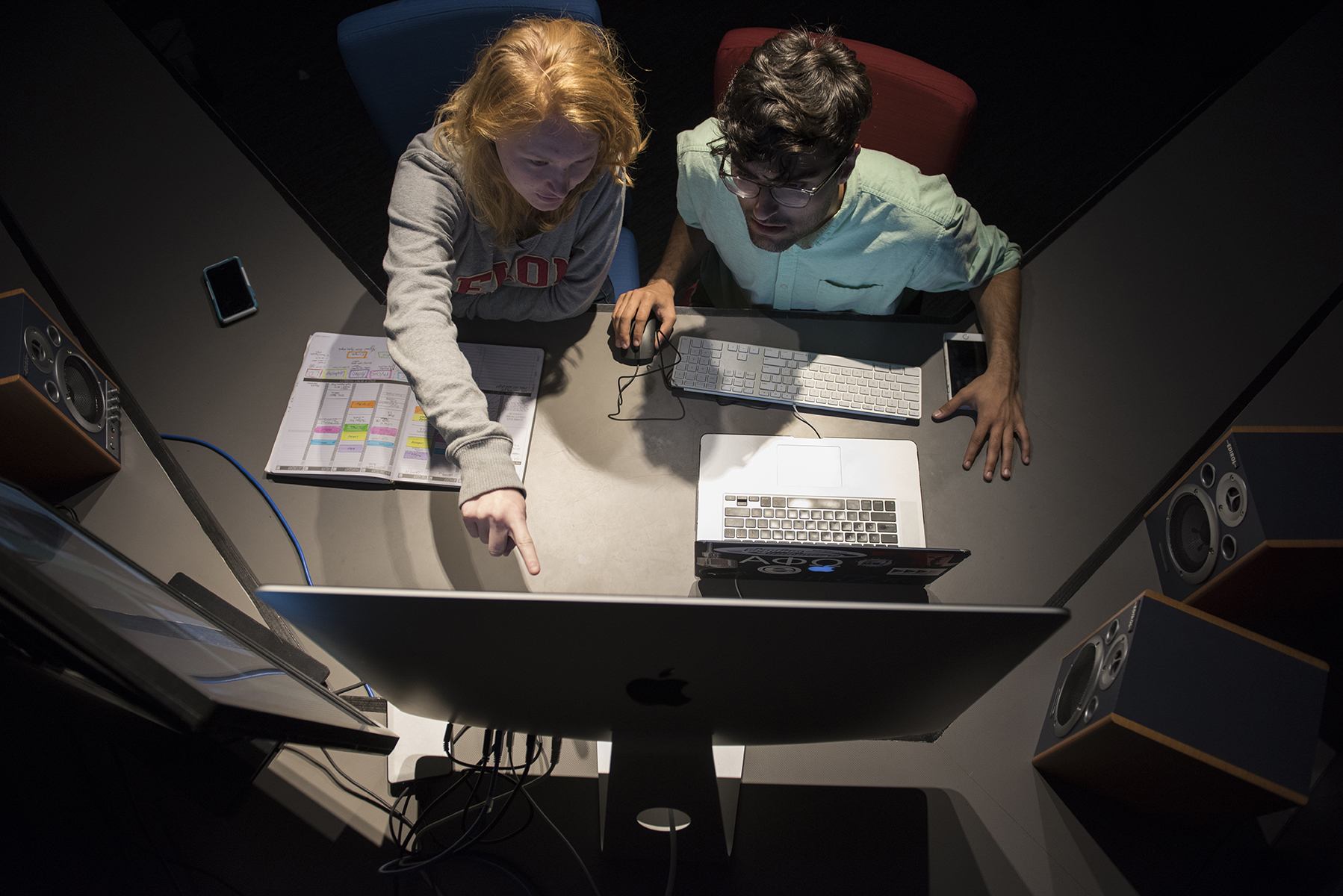 Anna Zwingelberg and Fletcher Rowe work together in a video editing suite in the redesigned School of Communications facilities.