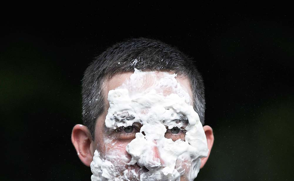 Steve Mencarini takes a pie in the face for charity at Elon University.