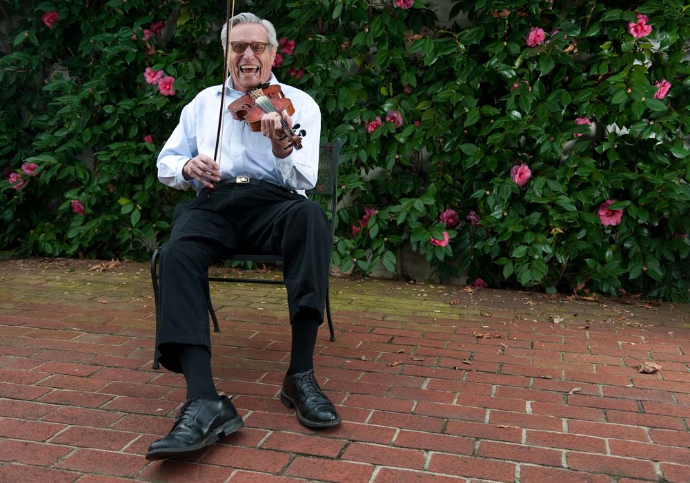 Dr. Jesse Meredith, recently honored by the American Medical Association for outstanding work, plays the fiddle at his Winston-Salem home. He's been a musician since he was a kid, and he found this particular violin at the end of WWII, inside a Daimler-Benz factory in Mannheim, Germany.