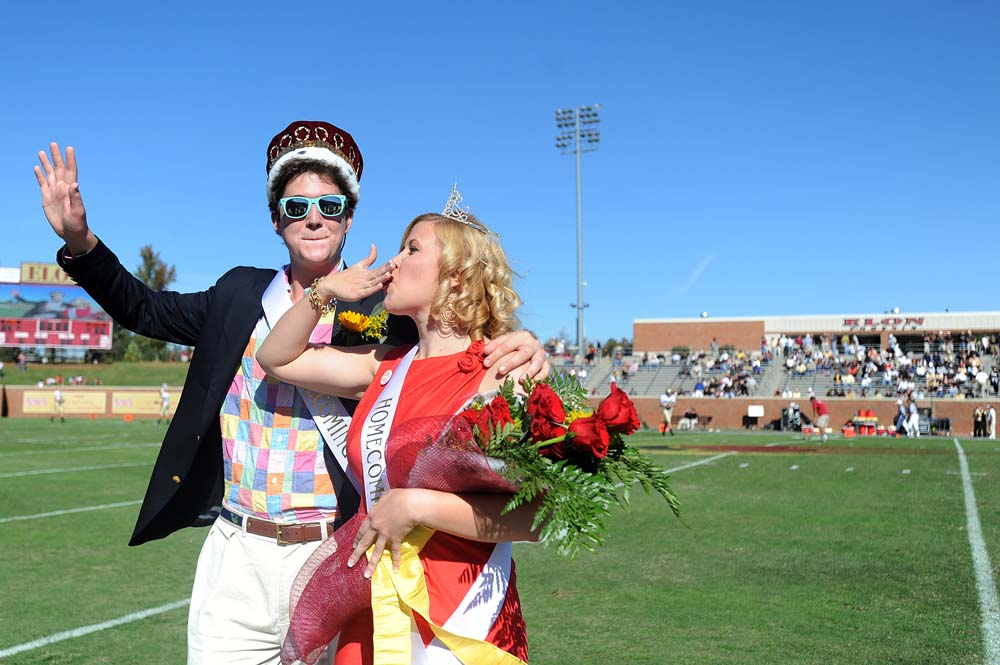 Homecoming queen, Kelli Accardi, wins the title for the third time. She and the king, Ian Maxwell, ham it up for the fans after the halftime announcement.