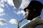 Peter Hazel plays tuba against the sunny sky during the New Rochelle, N.Y., Thanksgiving Day parade.
