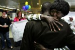 Sobbing as she sees Jimmy for the first time in five years, Alice clings to him after he arrived at the Greensboro, N.C., airport from Sudan. Alice's friends and supporters line up behind her, waiting for a turn to meet the man they struggled to get into the U.S.
