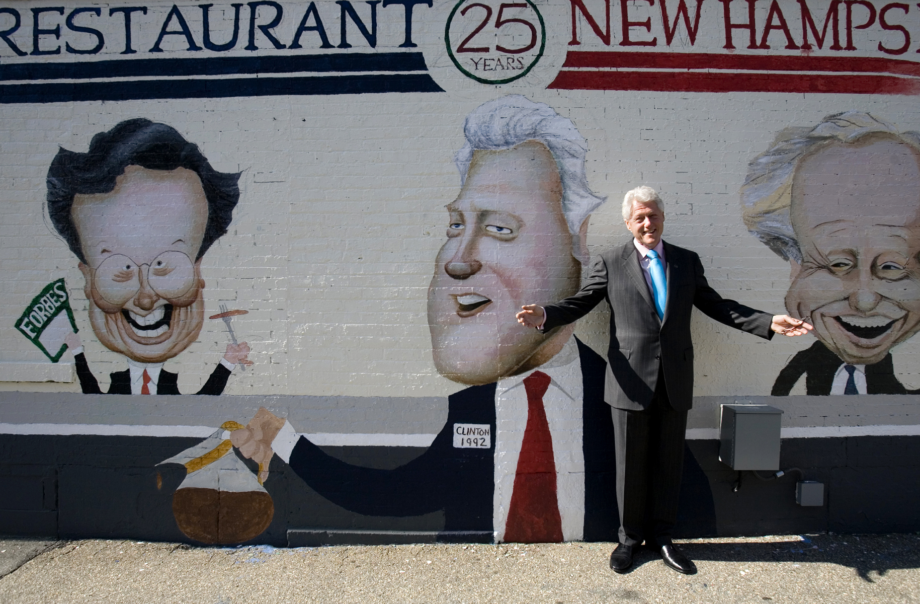 Former President Bill Clinton stops by a mural commemorating the 1992 New Hampshire Primary as he arrives at the Merrimack Restaurant in downtown Manchester, N.H. Clinton was in town to deliver a keynote speech at a local college.