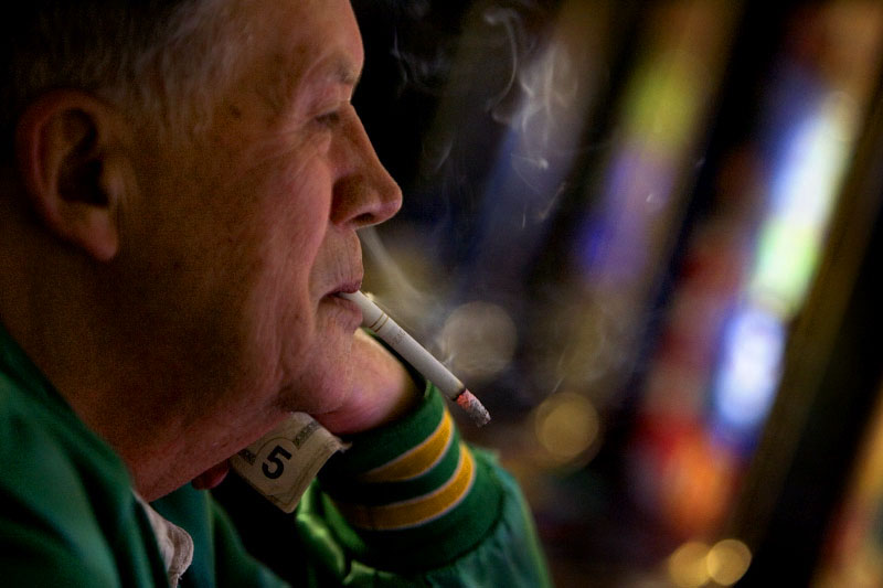 Ed O'Nail concentrates as he gambles electronically in the Corner Lounge in Corning, Ohio. In the 2006 election, Ohioans voted down the {quote}Learn & Earn{quote} bill, which would have created scholarship money for higher education with profits from Ohio casinos. Electronic gambling is legal in the state and controlled by individual counties.