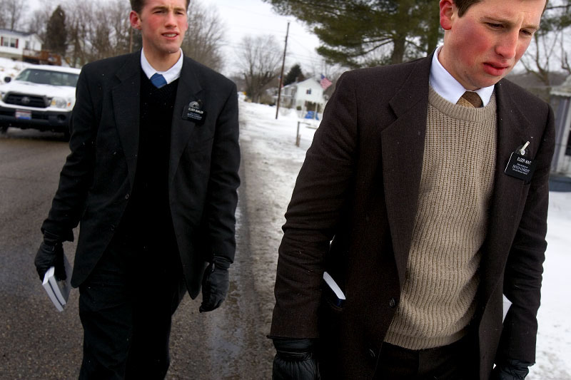 Elder Zack Bueller (left) and Elder Steven Wait brave the wind and snow in Millfield, Ohio, going door-to-door to speak to people about their faith, Mormonism. The two are on their two-year mission, in which they proselytize in a geographic area assigned by the church.