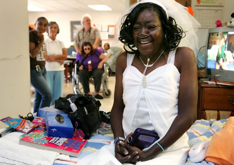 Although very nervous and teary-eyed, Annette Montford manages a smile as she prepares for her wedding at Park Place Health Center, a rehabilitation and nursing facility. A crowd of well wishers watches from the hallway.