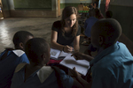Although these Malawian children have English skills, their reading comprehension skills are low. The American students brought books and writing materials from the U.S. for the English lessons.